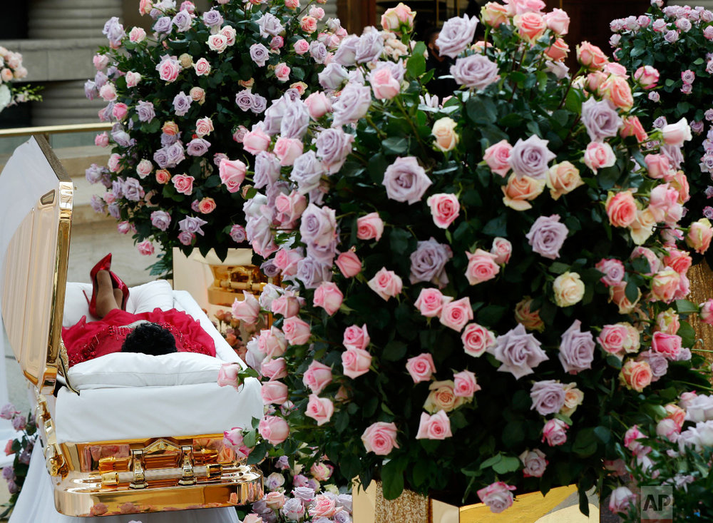 Aretha Franklin lies in her casket at the Charles H. Wright Museum of African American History in Detroit during a public visitation on Aug. 28, 2018. Franklin died on Aug. 16 of pancreatic cancer at the age of 76. (AP Photo/Paul Sancya, Pool)