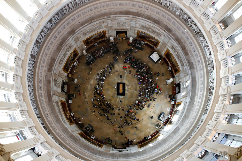 Visitors pay their respects as the casket of the Rev. Billy Graham lies in honor at the Rotunda of the U.S. Capitol Building in Washington on Feb. 28, 2018. (AP Photo/Jacquelyn Martin)