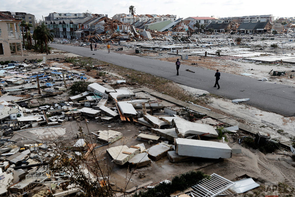 Rescue personnel search through debris in the aftermath of Hurricane Michael in Mexico Beach, Fla., on Oct. 11, 2018. (AP Photo/Gerald Herbert)
