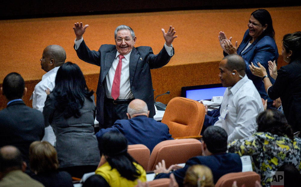 Outgoing President Raul Castro raises his arms in celebration after Miguel Diaz-Canel was elected as the island nation's new president, at the National Assembly in Havana, Cuba on April 19, 2018. Castro passed Cuba's presidency to Diaz-Canel, putting the island's government in the hands of someone outside the Castro family for the first time in nearly six decades. Raul Castro remains head of the powerful Communist Party that oversees political and social activities. (Adalberto Roque/Pool via AP)