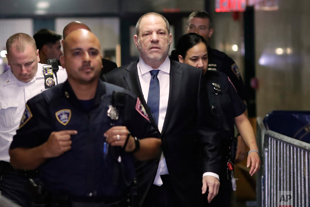 Harvey Weinstein, center, enters State Supreme Court in New York on Oct. 11, 2018. A year earlier, Weinstein was a catalyst in launching the #MeToo movement, which took off in October 2017 after reports in The New Yorker and The New York Times detailed multiple allegations of sexual misconduct against him. (AP Photo/Mark Lennihan)