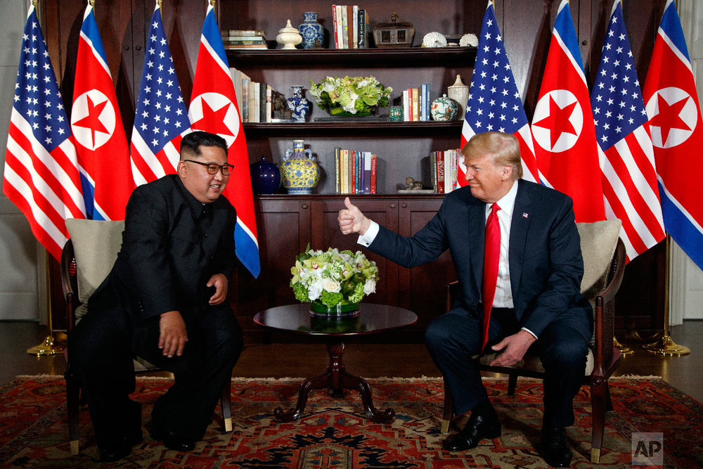 President Donald Trump meets with North Korean leader Kim Jong Un on Sentosa Island in Singapore on June 12, 2018. (AP Photo/Evan Vucci)