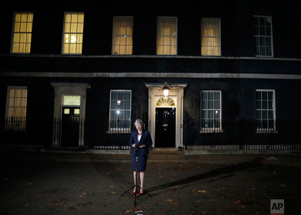 "Britain's Prime Minister Theresa May announces that her Cabinet has agreed to a draft Brexit deal with the European Union after ""impassioned"" debate, outside 10 Downing Street in London, on Nov. 14, 2018. (AP Photo/Matt Dunham)"