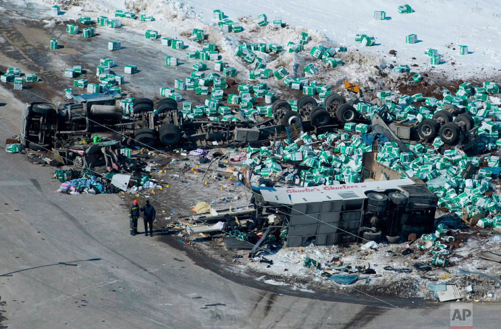 Emergency personnel work at the scene of a fatal crash outside of Tisdale, Saskatchewan, Canada, on April, 7, 2018, the morning after a bus carrying the Humboldt Broncos junior hockey team, en route to Nipawin, crashed into a truck, killing 14 and sending over a dozen more to the hospital. (Jonathan Hayward/The Canadian Press via AP)