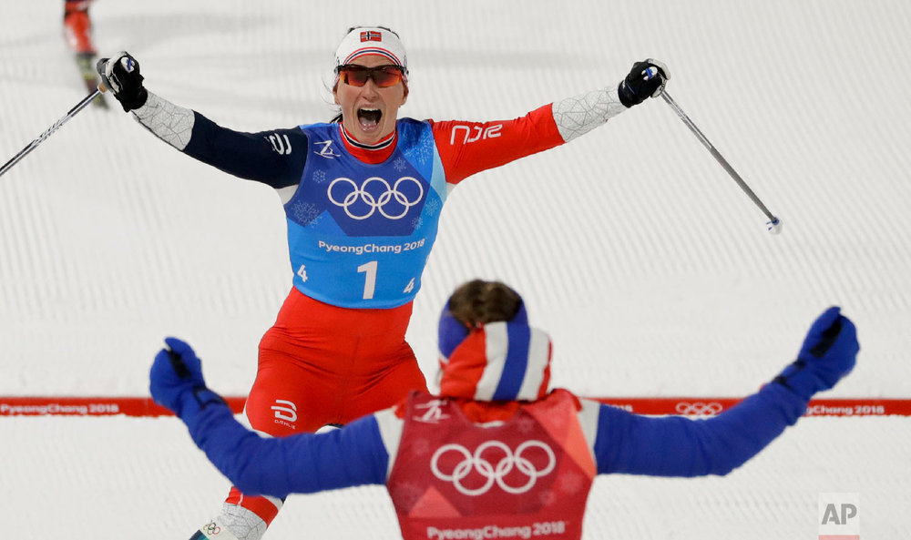 Marit Bjoergen, top, of Norway, celebrates with teammate Ingvild Flugstad Oestberg after winning the women's 4 x 5km relay cross-country skiing competition at the 2018 Winter Olympics in Pyeongchang, South Korea, on Feb. 17, 2018. (AP Photo/Kirsty Wigglesworth)