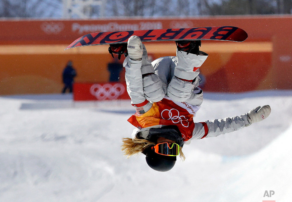 Chloe Kim, of the United States, jumps during the women's halfpipe finals at the 2018 Winter Olympics in Pyeongchang, South Korea, on Feb. 13, 2018. (AP Photo/Lee Jin-man)