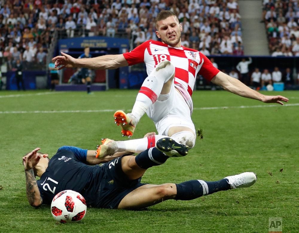 Croatia's Ante Rebic, top, tackles France's Lucas Hernandez during the final match between France and Croatia at the 2018 soccer World Cup in the Luzhniki Stadium in Moscow, Russia, on July 15, 2018. (AP Photo/Francisco Seco)