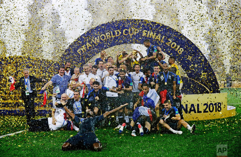 The French team celebrates after winning the final match against Croatia at the 2018 soccer World Cup in the Luzhniki Stadium in Moscow, Russia, on July 15, 2018. (AP Photo/Matthias Schrader)