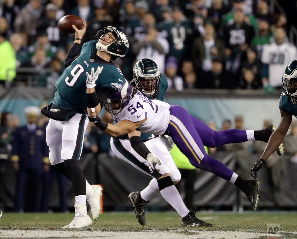 Philadelphia Eagles quarterback Nick Foles throws as he's hit by Minnesota Vikings' Eric Kendricks during the first half of the NFL football NFC championship game on Jan. 21, 2018, in Philadelphia. (AP Photo/Matt Slocum)