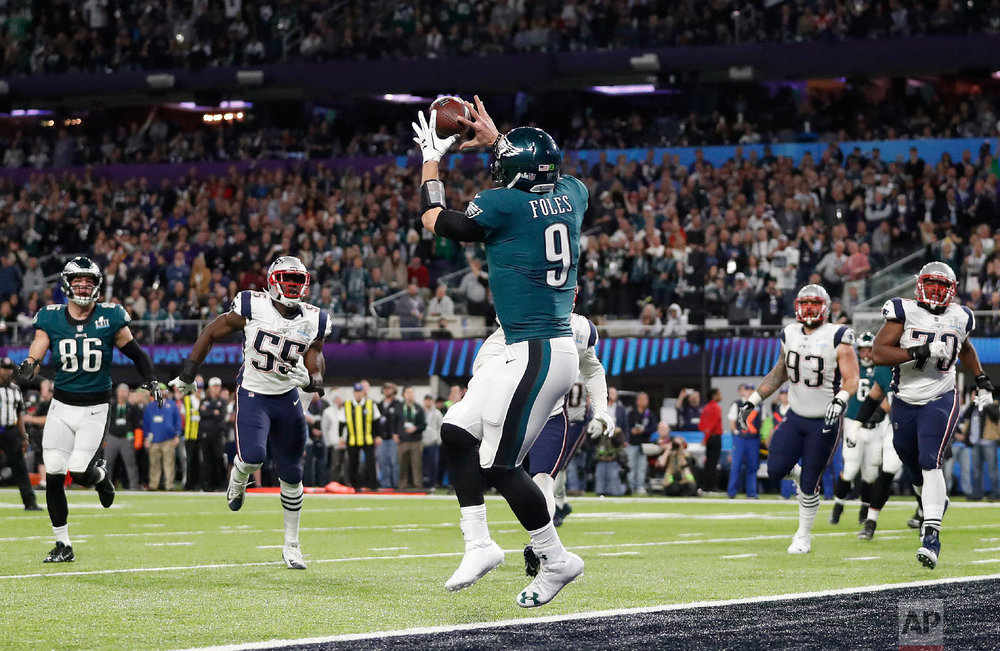 Philadelphia Eagles' Nick Foles catches a touchdown pass during the first half of the NFL Super Bowl 52 football game against the New England Patriots on Feb. 4, 2018, in Minneapolis. (AP Photo/Jeff Roberson)