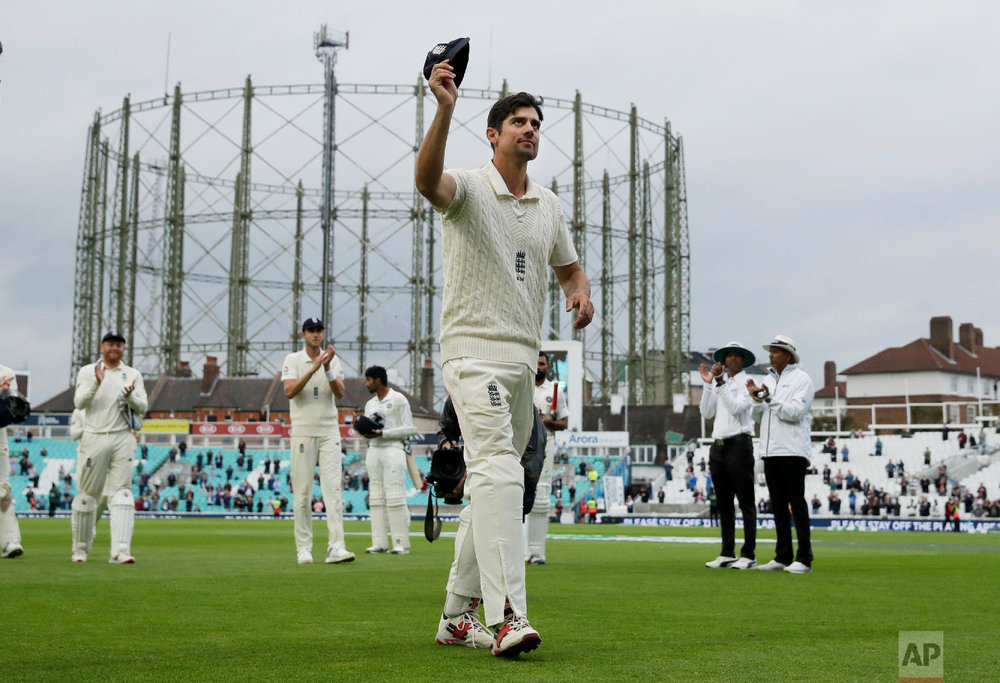 England's Alastair Cook, at the end of his final match before retiring from test cricket, raises his cap as he walks off at the end of the fifth cricket test match of a five match series between England and India at the Oval cricket ground in London, on Sept. 11, 2018. (AP Photo/Matt Dunham)