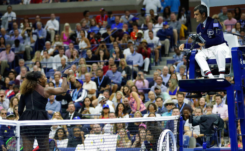 Serena Williams argues with chair umpire Carlos Ramos during a match against Naomi Osaka, of Japan, in the women's final of the U.S. Open tennis tournament on Sept. 8, 2018, in New York. (AP Photo/Julio Cortez)