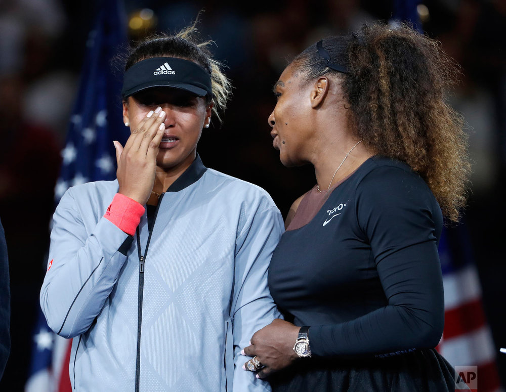 Serena Williams talks with Naomi Osaka, of Japan, after Osaka defeated Williams in the women's final of the U.S. Open tennis tournament on Sept. 8, 2018, in New York. (AP Photo/Adam Hunger)
