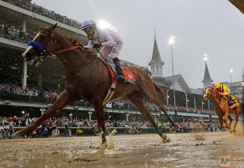 Mike Smith rides Justify to victory during the 144th running of the Kentucky Derby horse race at Churchill Downs on May 5, 2018, in Louisville, Ky. (AP Photo/Morry Gash)