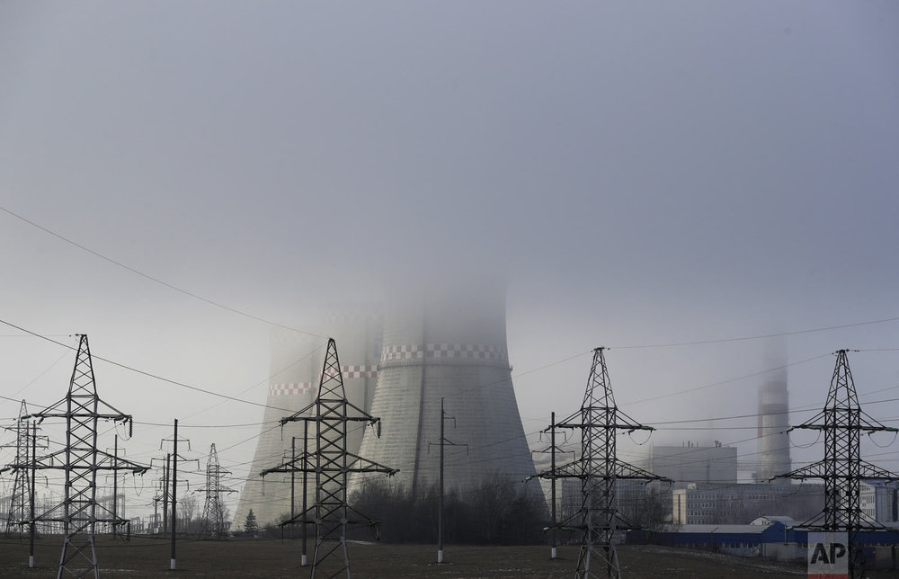 A power plant is partially obscured by fog in Minsk, Belarus, on Thursday, Dec. 6, 2018. The two-week U.N. climate meeting COP24 in Poland is intended to finalize details of the 2015 Paris accord on keeping average global temperature increases well below 2 degrees Celsius (3.6 Fahrenheit). (AP Photo/Sergei Grits)