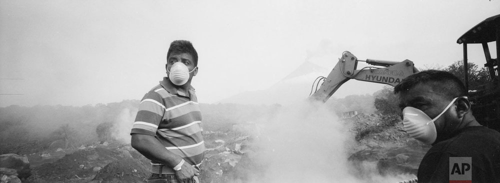 Elmer Vazquez stands amid volcanic ash and dust as he searches for the remains of his wife and five children who were killed by the eruption of the Volcan de Fuego, or Volcano of Fire, at his home buried in volcanic ash in San Miguel Los Lotes, Guatemala, June 14, 2018. (AP Photo/Rodrigo Abd)