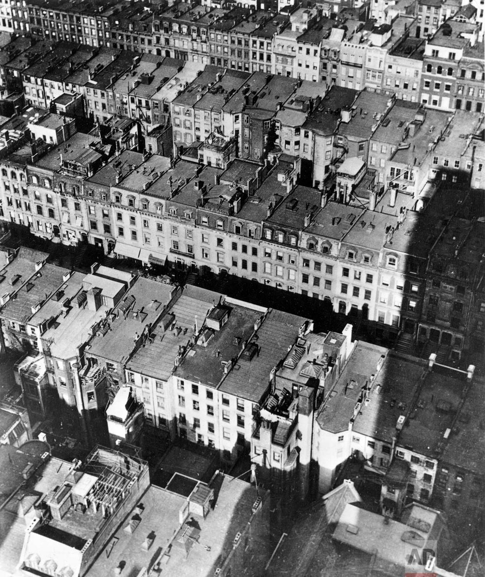 This aerial view shows the site of the projected Rockefeller Center in New York, prior to the beginning of demolition works, in June 1930. Two hundred and twenty-nine brownstone buildings are to be demolished in a three block area, stretching from West 48th Street to West 51st Street, and between Fifth and Sixth Avenues, to make way for the $250,000,000 commercial and cultural complex in the heart of New York City. (AP Photo)