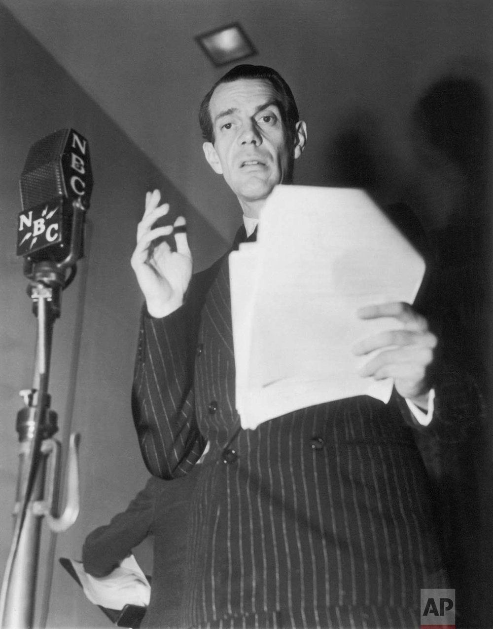 "Actor Raymond Massey performs as Abraham Lincoln for the radio play, ""Ninety Years of News"", a dramatization by the National Broadcasting Company (NBC), celebrating what was then believed to be AP's 90th anniversary, December 25, 1938 in New York. (AP Photo)"