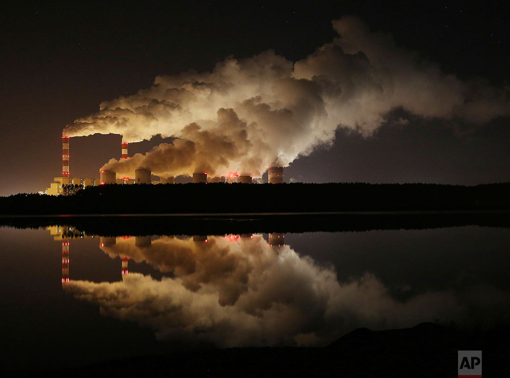 In this Wednesday, Nov. 28, 2018 photo, plumes of smoke rise from Europe's largest lignite power plant in Belchatow, central Poland. (AP Photo/Czarek Sokolowski)