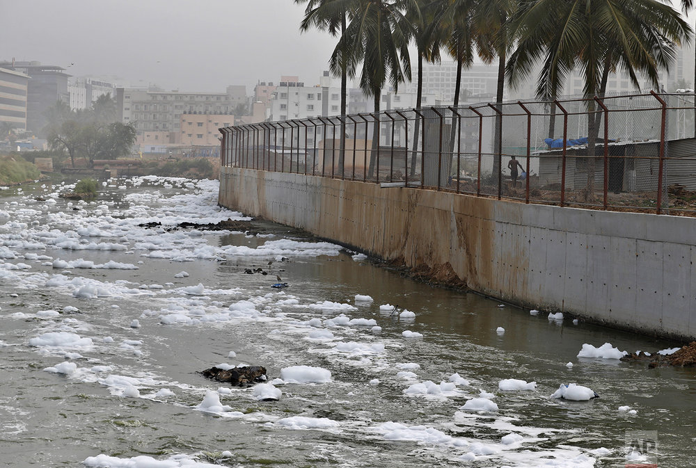 In this Monday, Dec. 10, 2018 photo, toxic froth from industrial pollution floats on Bellundur Lake in Bangalore, India. (AP Photo/Aijaz Rahi)