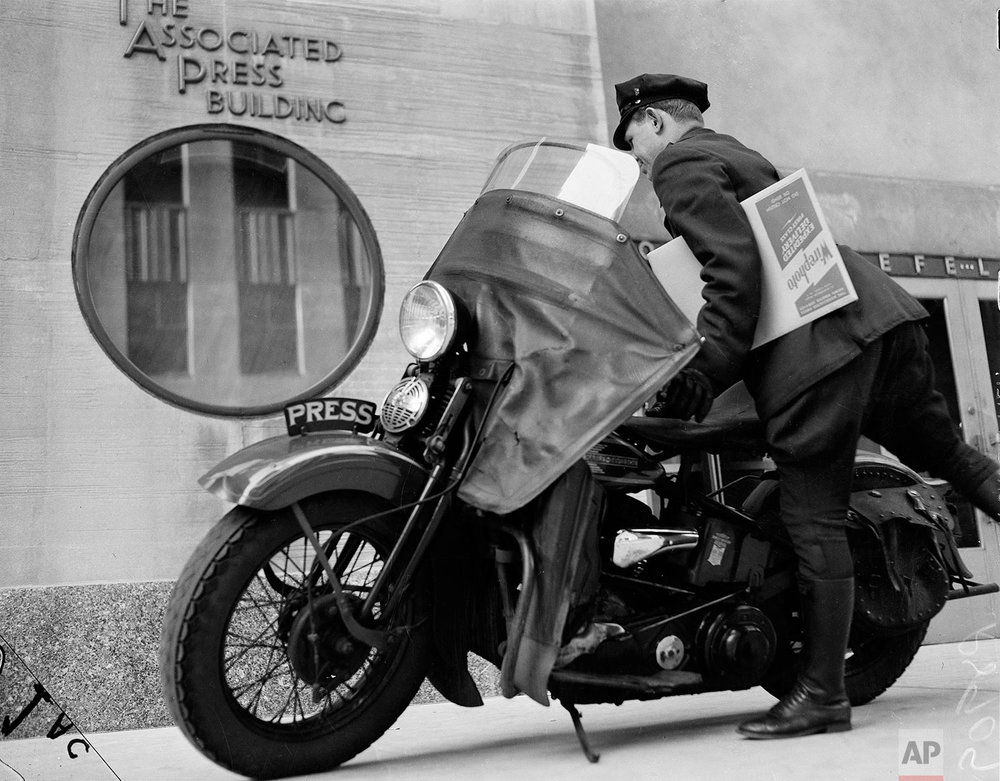 AP motorcycle messenger Pete Schivilla departs AP headquarters at 50 Rockefeller Plaza with a photo package destined for one of New York's daily newspapers in March 1939. Although the AP had been transmitting photos by wire for four years, competitive big-city dailies also wanted original prints. (AP Photo/Anthony Camerano)