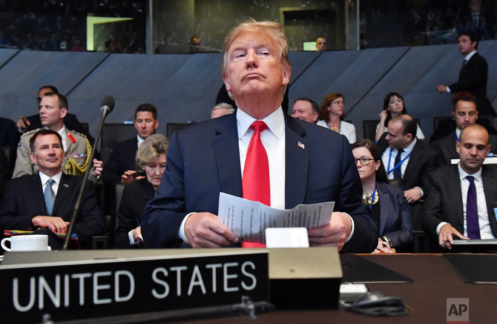 U.S. President Donald Trump attends a meeting of the North Atlantic Council during a summit of heads of state and government at NATO headquarters in Brussels on July 11, 2018. (AP Photo/Geert Vanden Wijngaert)