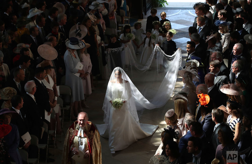Meghan Markle walks down the aisle as she arrives for the wedding ceremony to Prince Harry at St. George's Chapel in Windsor Castle in Windsor, near London, England on May 19, 2018. (Danny Lawson/pool photo via AP)