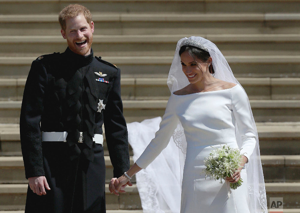 Meghan Markle and Britain's Prince Harry stand on the steps of St George's Chapel at Windsor Castle following their wedding in Windsor, near London, England on May 19, 2018. (Jane Barlow/pool photo via AP)