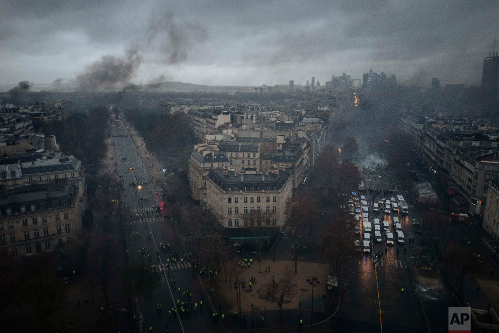 Avenues leading to the Arc de Triomphe are pictured from the top of the Arc de Triomphe on the Champs-Elysees avenue during a demonstration in Paris on Dec. 1, 2018. (AP Photo/Kamil Zihnioglu)