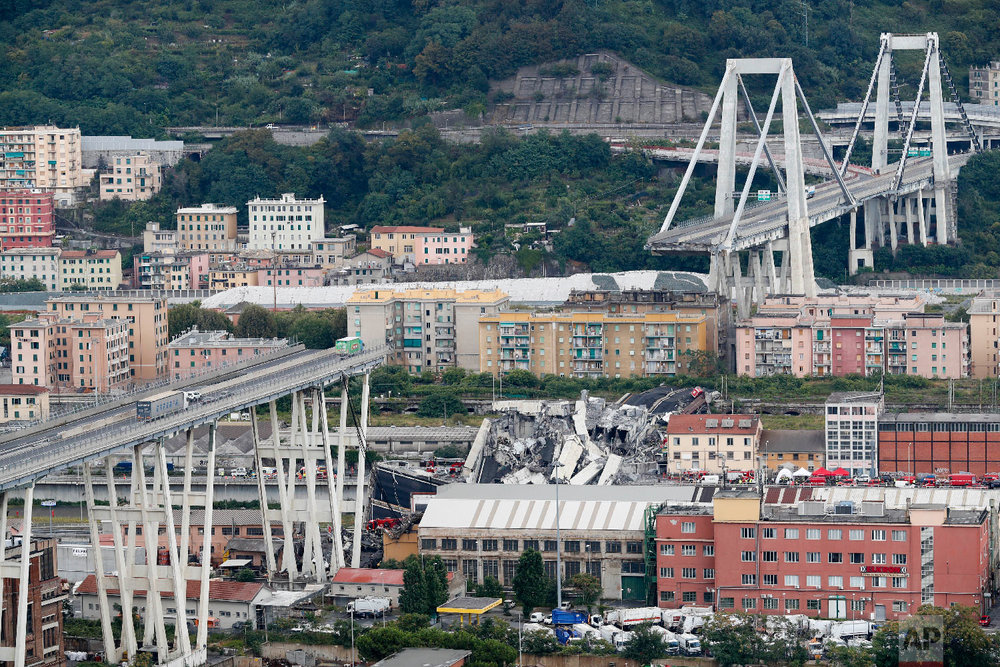 Cars are blocked on the Morandi highway bridge after a section of it collapsed, in Genoa, northern Italy. (AP Photo/Antonio Calanni)
