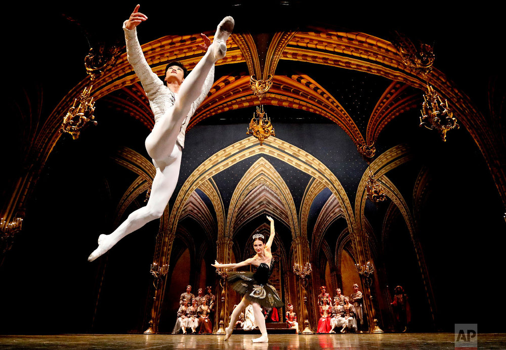 Dancers Kimin Kim and Yulia Stepanova of the St Petersburg Ballet perform Swan Lake during a photo call at the Coliseum theatre in London on Aug. 21, 2018. (AP Photo/Frank Augstein)