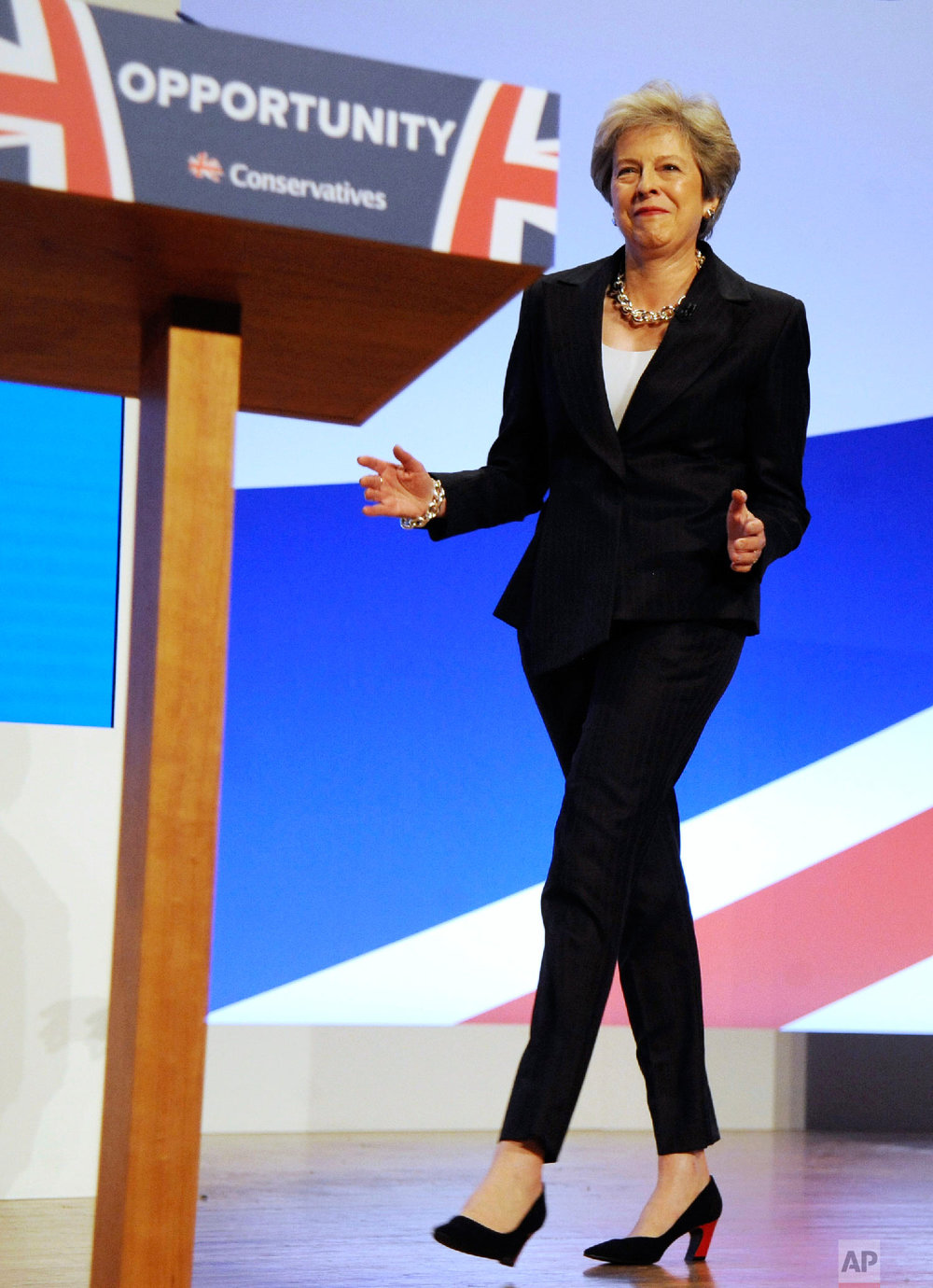 Conservative Party Leader and Prime Minister Theresa May dances as she arrives on stage to address delegates during a speech at the Conservative Party Conference at the ICC, in Birmingham, England on Oct. 3 , 2018. (AP Photo/Rui Vieira)