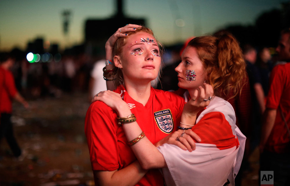 England soccer fans react after England national soccer team lost the semifinal match between Croatia and England at the 2018 soccer World Cup, in Hyde Park, London on July 11, 2018. (AP Photo/Matt Dunham)