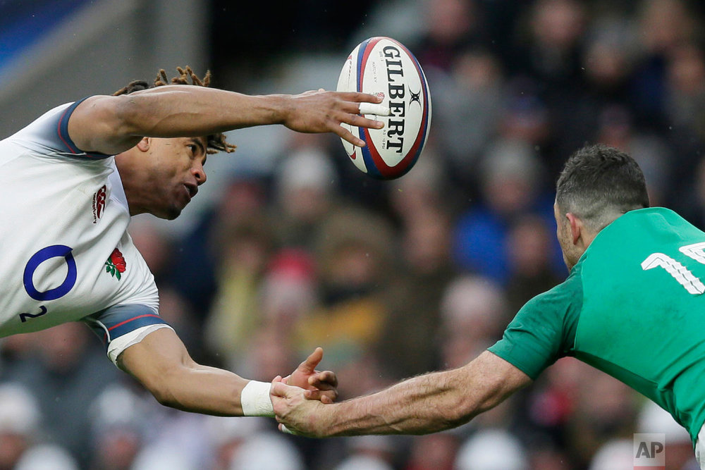 England's Anthony Watson, left, and Ireland's Rob Kearney try to catch the ball during the Six Nations rugby union match between England and Ireland at Twickenham stadium in London on March 17, 2018. (AP Photo/Tim Ireland)