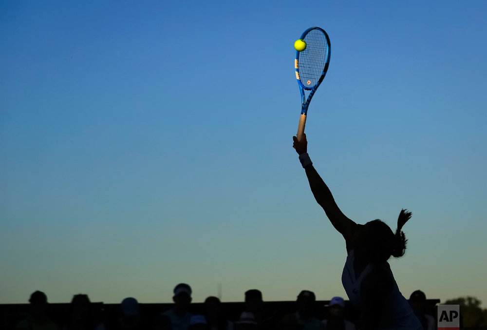 Julia Goerges of Germany serves to Monica Puig of Puerto Rica during the Women's Singles first round match at the Wimbledon Tennis Championships in London on July 2, 2018. (AP Photo/Ben Curtis)