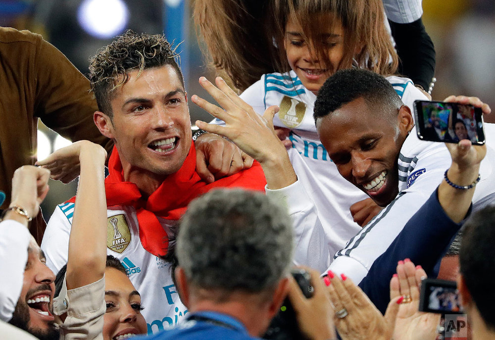 Real Madrid's Cristiano Ronaldo celebrates with fans after winning the Champions League Final soccer match between Real Madrid and Liverpool at the Olimpiyskiy Stadium in Kiev, Ukraine on May 26, 2018. (AP Photo/Sergei Grits)