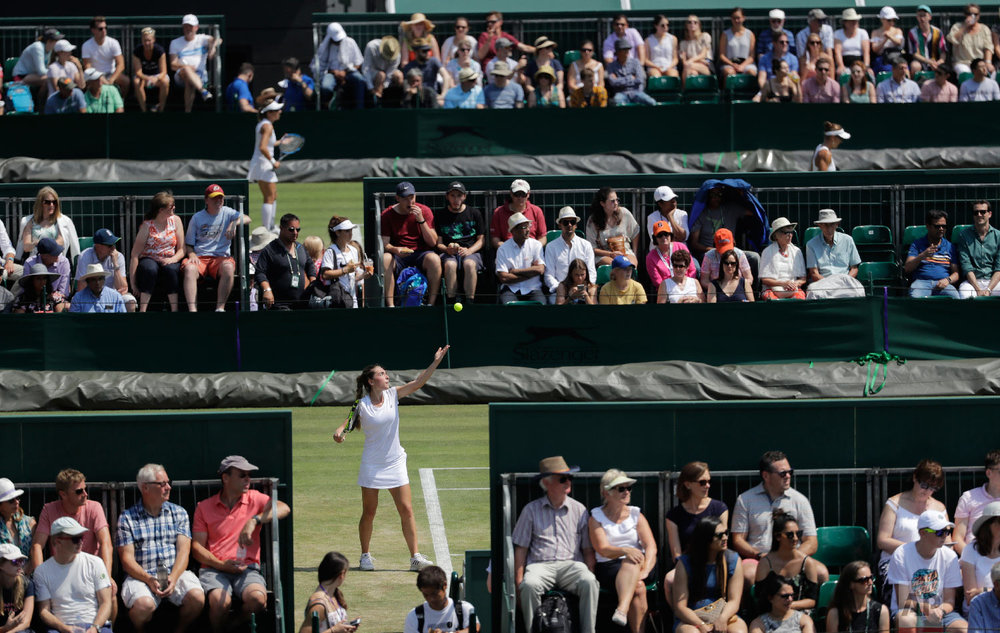 Eleonora Molinaro of Luxembourg serves to Natasha Subhash of the US during their girls' singles match on the sixth day at the Wimbledon Tennis Championships in London on July 7, 2018. (AP Photo/Ben Curtis)