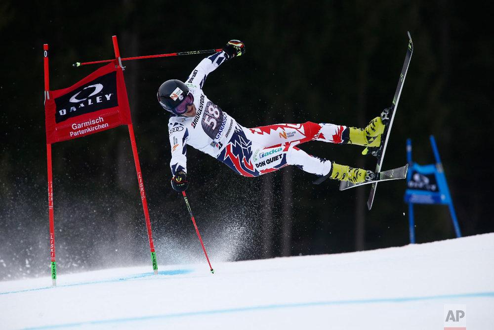 Czech Republic's Krystof Kryzl crashes during the first run of an alpine ski, men's World Cup giant slalom, in Garmisch Partenkirchen, Germany on Jan. 28, 2018. (AP Photo/Giovanni Auletta)