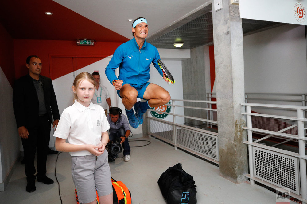 Spain's Rafael Nadal jumps in a corridor before his men's final match of the French Open tennis tournament against Austria's Dominic Thiem at the Roland Garros stadium in Paris on June 10, 2018. (AP Photo/Christophe Ena)