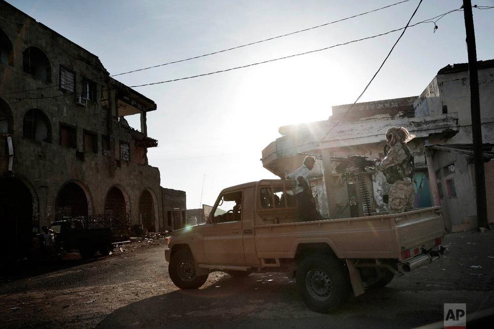 Saudi-led coalition backed forces patrol Mocha, Yemen, Feb. 12, 2018. (AP Photo/Nariman El-Mofty)