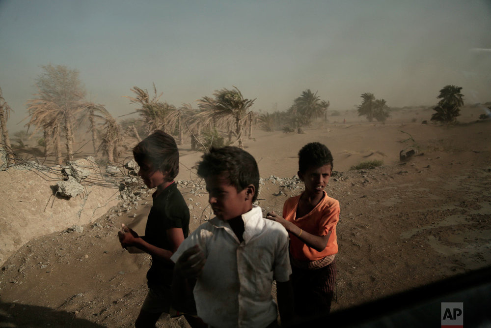 Homeless children stand on the road from Khoukha to Taiz in Yemen on Feb. 12, 2018.(AP Photo/Nariman El-Mofty, File)