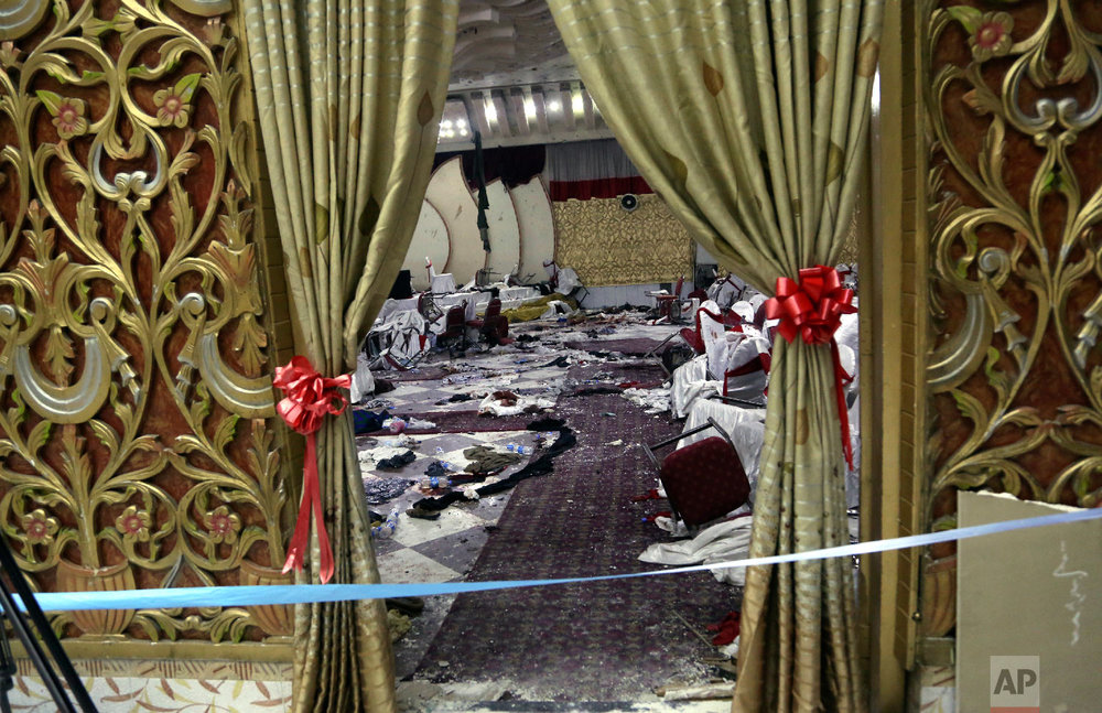 Inside of a wedding hall in Kabul, Afghanistan, is seen, Nov. 21, 2018, a day after a suicide attack. A suicide bomber was able to sneak into the wedding hall where hundreds of Muslim religious scholars and clerics had gathered to mark the birthday of the Prophet Muhammad. (AP Photo/Rahmat Gul)
