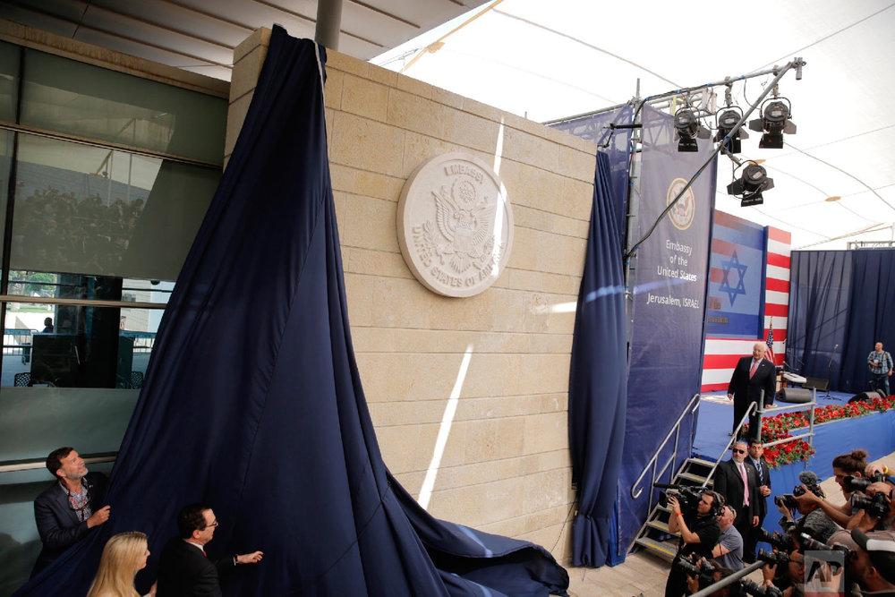 U.S. President Donald Trump's daughter Ivanka Trump, left, and U.S. Treasury Secretary Steve Mnuchin unveil an inauguration plaque during the opening ceremony of the new US embassy in Jerusalem, Monday, May 14, 2018. (AP Photo/Sebastian Scheiner)