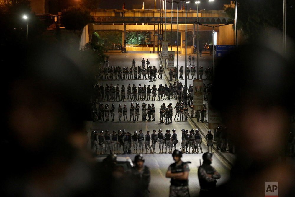 Jordanian security forces are on high alert in the capital of Amman, early Tuesday, June 5, 2018. (AP Photo/Raad al-Adayleh)