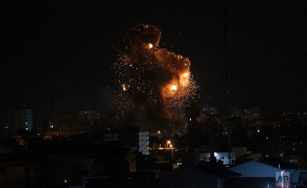 An explosion caused by Israeli airstrikes on the building of Hamas' Al-Aqsa TV station in Gaza City, Nov. 12, 2018.(AP Photo/Adel Hana)