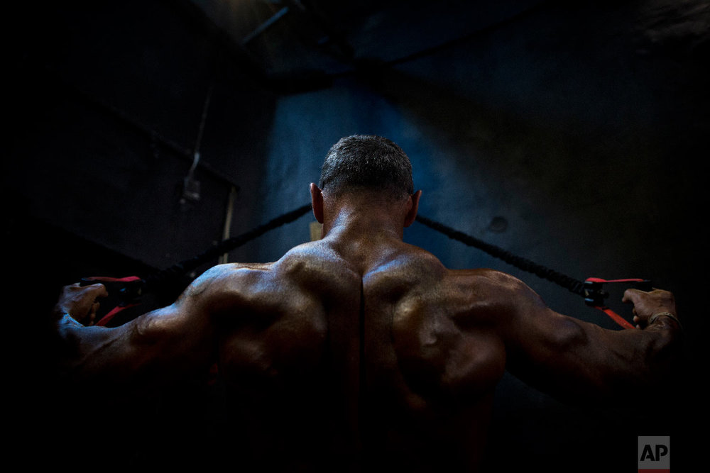 A contestant exercises backstage during the National Amateur Body Builders' Association competition in Tel Aviv, Israel, Oct. 18, 2018. (AP Photo/Oded Balilty)
