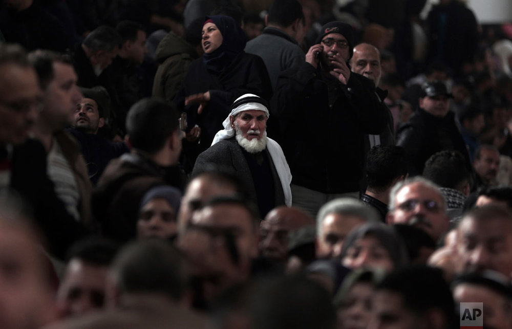 Palestinians wait for their turn to enter the Rafah border crossing with Egypt, in the southern Gaza Strip, Feb, 8, 2018. (AP Photo/ Khalil Hamra)