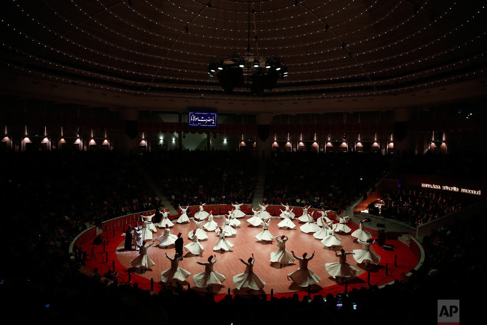 Whirling dervishes of the Mevlevi order perform at the start of a Sheb-i Arus ceremony in Konya, central Turkey, Sunday, Dec. 16, 2018. (AP Photo/Lefteris Pitarakis)