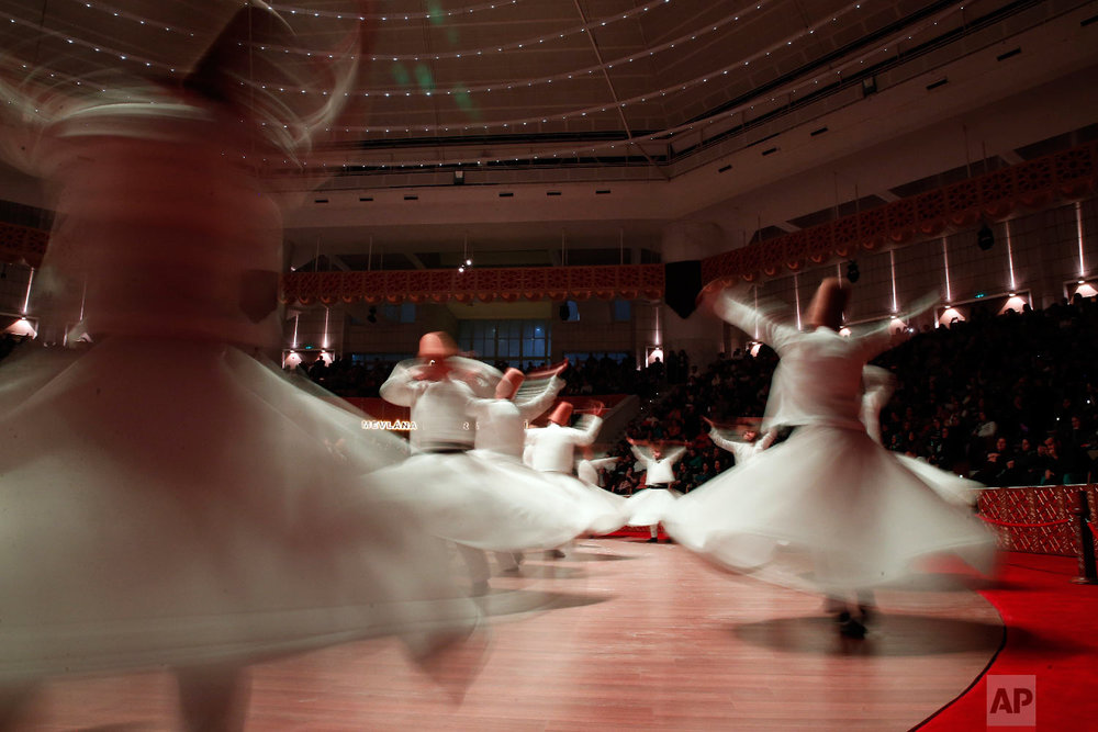 Whirling dervishes of the Mevlevi order perform during a Sheb-i Arus ceremony in Konya, central Turkey, Sunday, Dec. 16, 2018. (AP Photo/Lefteris Pitarakis)