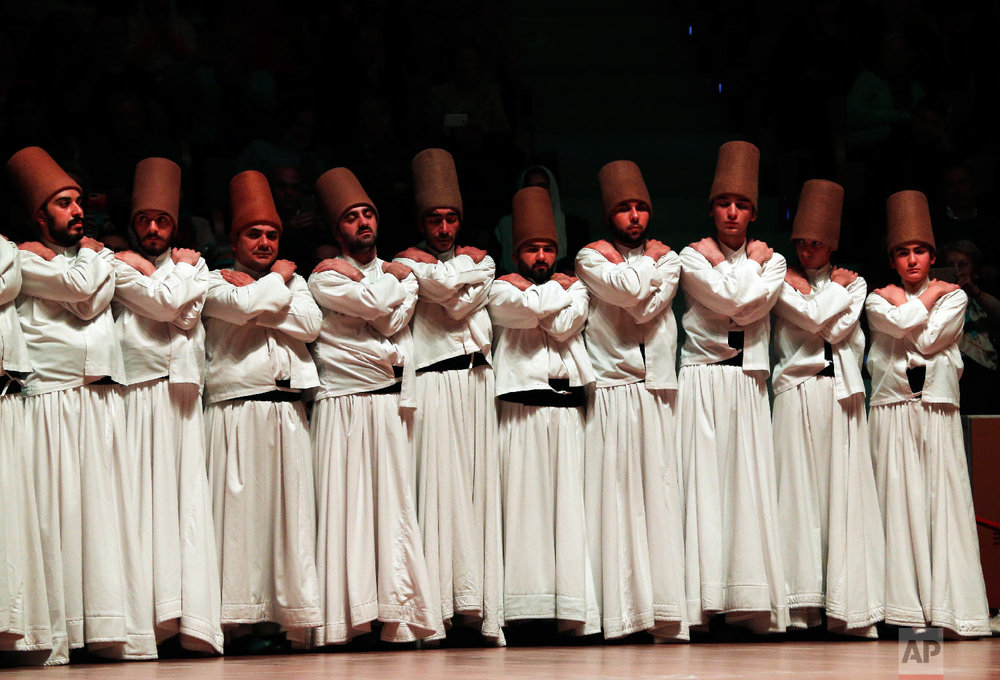 Whirling dervishes of the Mevlevi order prepare for the Sheb-i Arus ceremony in Konya, central Turkey, Sunday, Dec. 16, 2018. (AP Photo/Lefteris Pitarakis)